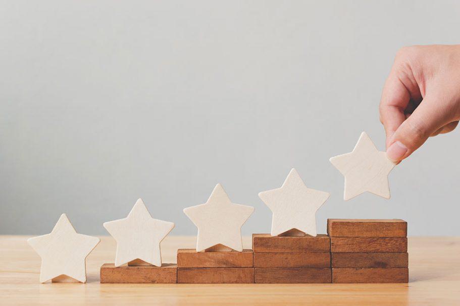 Folded paper stars lined up along a makeshift set of steps.