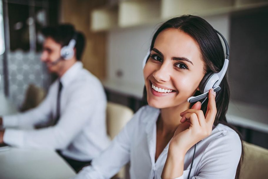 Young woman wearing a telephone headset, translating over the phone.